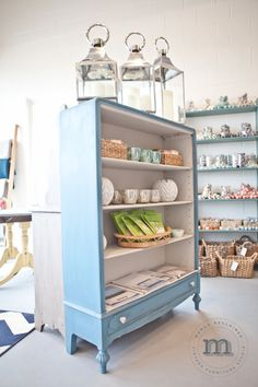 Painted in Miss Mustard Seed's Milk Paint 'French Enamel' and 'Grain Sack', this shelving unit is currently available for $525.