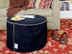 DIY Network has instructions on how to make a custom, inexpensive foot stool from a heavy-duty fabric and an upcycled wood spool originally used for electrical wire.