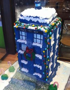 A Christmas-themed Tardis gingerbread house -  For all your cake decorating supplies, please visit craftcompany.co.uk