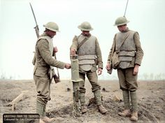 Three Irish Guards wearing German body-armour, examining a captured German machine-gun, at Pilckem, West Flanders, Belgium, during The Battle of Pilckem Ridge, 31st July 1917.  The Battle of Pilckem Ridge, 31 July – 2 August 1917, was the opening attack of the main part of the Third Battle of Ypres.