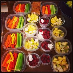 Sunday meal prep! Our snacks for the week: carrots, bell peppers, celery, ricotta cheese with raspberries, pineapple and pear, apricots :-)