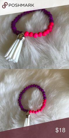NEW • tassel stretch bracelet New never worn pink and purple beads with the white tassel stretch string katdjewelry Jewelry Bracelets