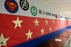 Hollywood theme event 2015 wall of fame fundraiser.  Wall of fame went all the way around the cafeteria,  hung gold cut out stars on red paper and students signed their names on them.