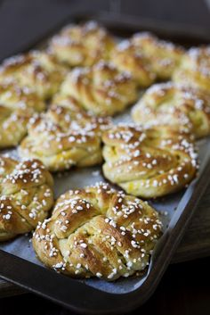 Swedish Orange Sweet Buns made with a buttery, cardamom dough layered with fragrant orange sugar, then knotted, topped with crunchy Swedish pearl sugar and baked until they're golden brown.