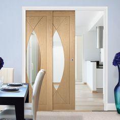 Twin Telescopic Pocket Pesaro Oak Veneer Door - Clear Glass.    #oakslidingdoors  #pocketdoors  #internaldoors  #doubledoors  #interiordesign