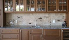 Kitchen  Glass Wall Cabinet Door Feat Creative Tiles Kitchen Backsplash With Fish Ornament Also Stone Countertop And Single Handle Faucet Awesome Tiled Kitchen Backsplash Design Ideas with Rail Pendant Lamps