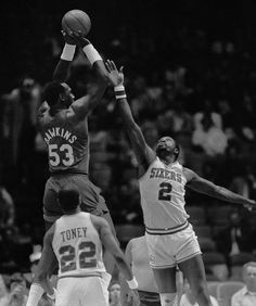 Moses Malone tries to block a shot by Darryl Dawkins in a 1984 game between the Philadelphia 76ers and New Jersey Nets. (Rusty Kennedy/AP file)