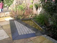 water feature by paperbark garden design in a garden near leeds yorkshire slate