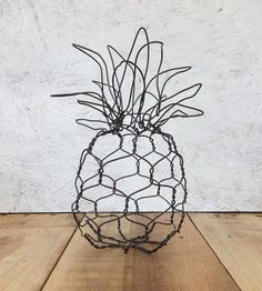 Inspired by baby pineapples, this wire sculpture looks like a scale replica of the tropical fruit. Top your desk with the decorative steel pineapple as a funky souvenir of an island getaway or keep it in the kitchen as a fruity pick-me-up.