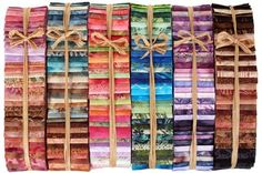 """HOFFMAN BALI POPS! Each Bali Pop includes 40 - 2 1/2"""" x 44"""" strips of Hoffman batik fabric in colors of Cherry, Blueberry, Watermelon, Key Lime, Plum Pudding, or Coconut!"""
