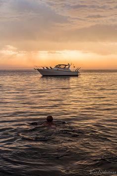 swimming under sunrise by Ilias Anthitsas on 500px