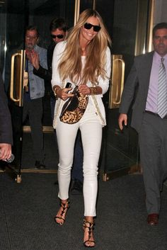 Total white, animal print and gold for Elle McPherson