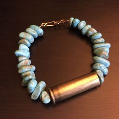 """Turquoise bracelet with brass bullet A gift from an ex that posh suggested I get rid of. Real turquoise bracelet with brass bullet casing and clasp. Would comfortably fit up to a 6.5"""" wrist. Handmade Jewelry Bracelets"""