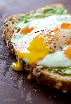 This is MY kind of egg sandwich! Whole grain toast with mashed avocado, a runny egg and a few...