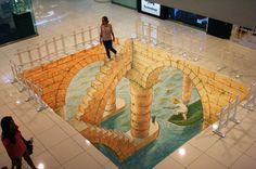 30 Examples of 3D Street Art | Cuded 7. Eduardo Relero  This Spanish 3D street artist created amazing indoor and outdoor illusions. This one may be inspired by Escher.