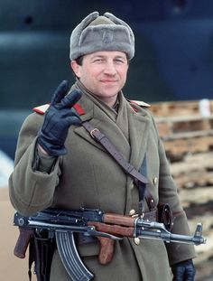 A Romanian soldier gives the victory sign on New Year's Eve 1989, he has removed the communist insignia from his headwear.
