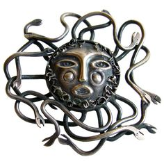 "vintage 1960s sterling silver Medusa design brooch pin - signed ""Emaus 925"" and Eagle 1 - from the Emaus workshop of the Benedictine Monks of Cuernavaca, Mexico. Measures 2-1/4"" in diameter."