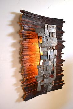 Functional Art. Light made entirely from recycled wine barrel staves and rings.: