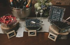 I like the champagne bar and easy boutonnieres... babies breath wrapped in twine.