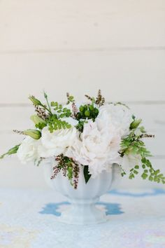 Centerpiece idea. Love the glassware and the wild greens and garden blooms