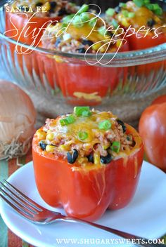 Santa Fe Stuffed Peppers: a healthy dinner made with ground turkey. Lots of flavor! #stuffedpeppers #healthy #dinner www.shugarysweets.com
