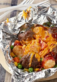 All-in-One Meatball 'n Potato Nugget Packets – Foil-pack cooking makes dinnertime meal preparation a breeze! Fire up the grill and try out these cheesy meatball and potato nugget packets!