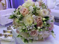 Gorgeous bridal bouquet with roses, eustoma and bouvardia! Chanan's Floral Events