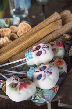 Día de los Muertos celebration with churros and sugar skulls