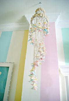 Everyday is a Holiday: Salt Water Taffy Striped Bathroom - pretty shell mobile.