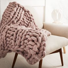 It's all about the chunky knit. Huge stitches make the cosiest blankets in the world and the beautiful Mink colour works perfectly with any colour scheme.