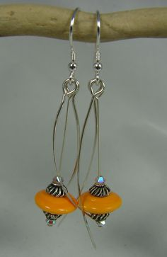 SOLD Tangerine silver feather earrings!