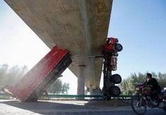 Truck crash..china...man did u not see that big bridge