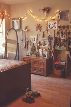 Laura of Roots and Feathers Boho Bedroom. I like how she uses the hat wrack for her bracelets.- Love the mirror and chest!