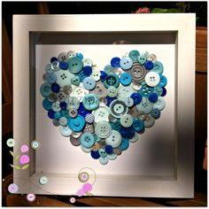 Blues, greys and mother of pearl button heart in a professionally handmade box frame. From Marzipan Crafts £32.00