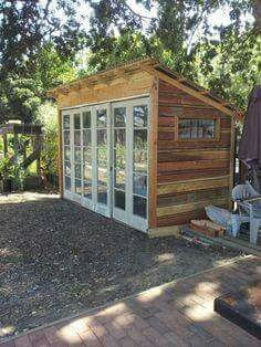 Reclaimed tool shed using French doors and fencing.