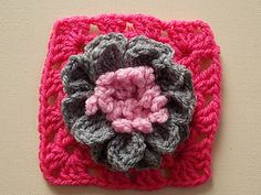 http://www.ravelry.com/patterns/library/3d-flower-granny-square-flower-can-be-made-seperate