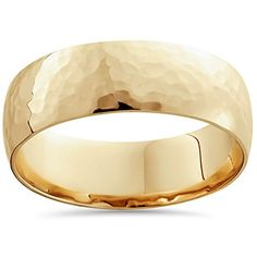 Men's ring features a polished hammered finish. Ring is made of solid 14k yellow gold....
