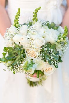 Pretty bridal bouquet with baby's breath, roses, and succulents