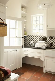 This dog nook is tucked away in the world's cutest laundry room and is framed wi. This dog nook is tucked away in the world's cutest laundry room and is framed with decorative braces. Black And White Backsplash, White Tile Backsplash, White Tiles, Black Counters, Beadboard Backsplash, Herringbone Backsplash, Backsplash Ideas, Vinyl Beadboard, Countertop Backsplash