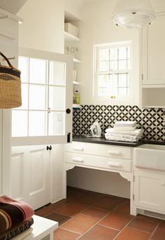 Tim Barber - modern Spanish colonial in LA. Tile backsplash modernizes classic 30's cabinetry