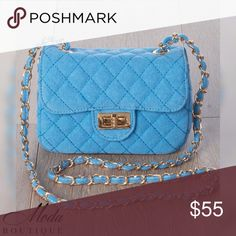 """'Elisa' Night Out CB Clutch - Blue Color: BLUE  Your big night on the town won't be complete without our 'Elisa' Cross Body Clutch.   Availible in 5 colors,  Beige, Black, Blue, Olive, and Pink to match any outfit.   Features  *Cross body stitching  *Twist Lock front flap  *Shoulder strap  *Gold accent metal detail buckle and strap  Material: Polyurethane and mixed metals Size  Measurements: 7"""" Width 5"""" Height 3"""" Depth   Modabyboutique Moda Boutique Moda SF SFmoda wholesale @wholesales…"""