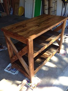 Kitchen island made from 2x4s and pallets