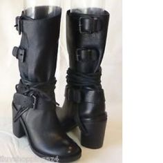 Vince Camuto Skylar boots, sz 7, LIKE NEW, worn just a couple of times. Gorgeous black leather with multiple harness straps. PRICEY and GORGEOUS!  Will ship right away!  Check out my other pricey items