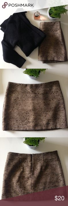 """Metallic tweed mini This thick tweed skirt is perfect for the upcoming holidays. I love it with a chunky turtleneck and pointy toed flats for a dressy-but-not-too-dressy look. In excellent used condition; freshly dry cleaned. Fully lined; back zipper. 15.75"""" wide at waist, laying flat; 14"""" long. Forever 21 Skirts Mini"""