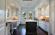Laundry / Mud Room with island, and a huge classic sink perfect for bathing puppies...