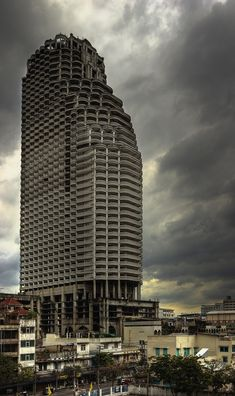 """Sathorn Unique, aka: """"ghost tower"""" sits abandoned in Bangkok after funds ran out to complete construction of the residential highrise in the late 1990s."""