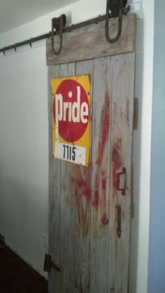 Our barn door pantry with vintage signage