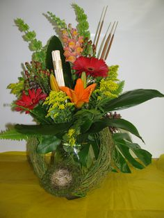 Unique tropicals add a beautiful punch to this arrangement!