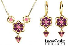 Feminine Jewelry Set: Necklace and Earrings Designed by Lucia Costin with Star Shaped Flowers and Twisted Lines, Enhanced with Pink and Violet Swarovski Crystals; 14K Yellow Gold Plated over .925 Sterling Silver Lucia Costin. $125.00. Jewelry set designed by Lucia Costin. Style takes wings in this lovely jewelry set that have a graceful flower shape. Handmade in USA unique jewelry set. Crafted with rose and purple Swarovski crystals. Flowers and fancy ornaments beautifully combined