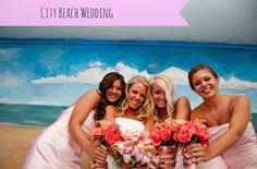 City beach wedding bridesmaids in pink on marrymemetro.com's 11 Amazing wedding theme ideas
